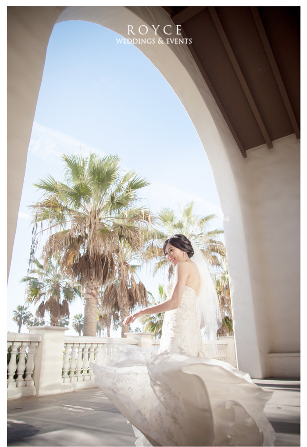 Wedding photography of bride in an elegant wedding gown at the Hyatt Huntington Beach http://RoyceWeddings.com Call: 626-560-2537