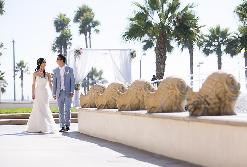 Couple taking photo at the Hyatt Huntington Beach after their first look as a great wedding ceremony ideas http://RoyceWeddings.com Call: 626-560-2537