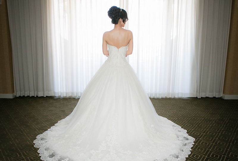 Bride in stunning wedding gowns getting ready at one of the top Orange County wedding venues http://RoyceWeddings.com Call: 626-560-2537