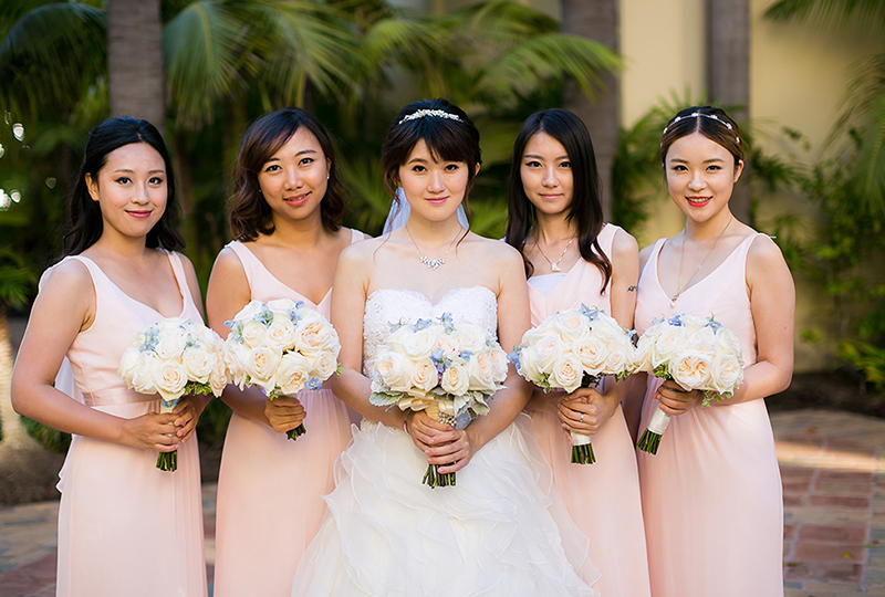 Beautiful bride with her bridesmaids in this unique wedding production.