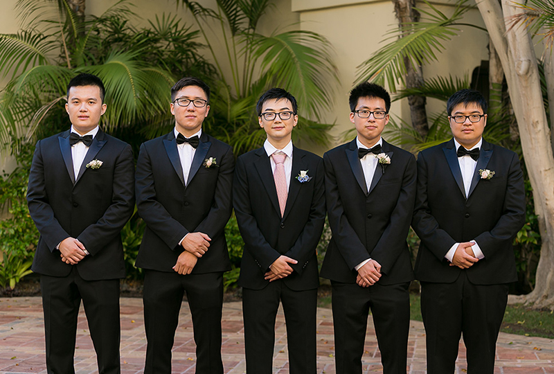 Handsome groom with his groomsmen created by a wedding production company.