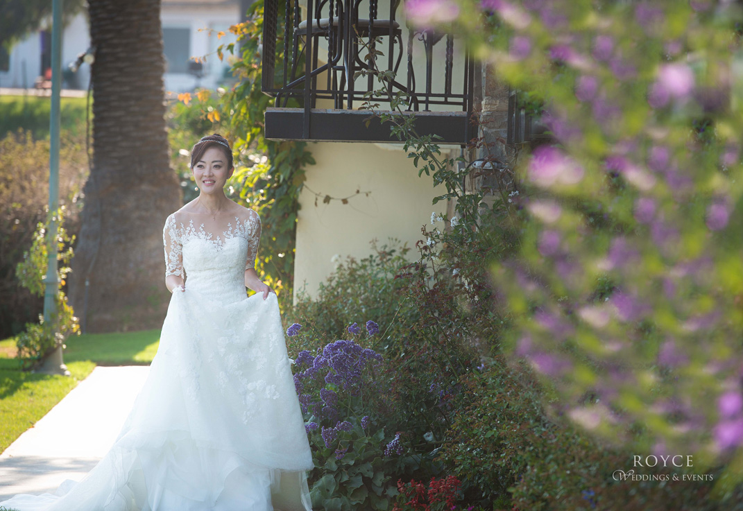 Bride walking outside the Bel Air Bay Club wedding room. http://RoyceWeddings.com Call: 626-560-2537