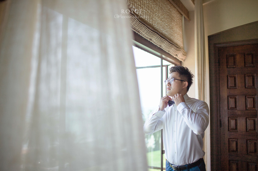 Groom looking out the window at the Bel Air Bay Club wedding room. http://RoyceWeddings.com Call: 626-560-2537