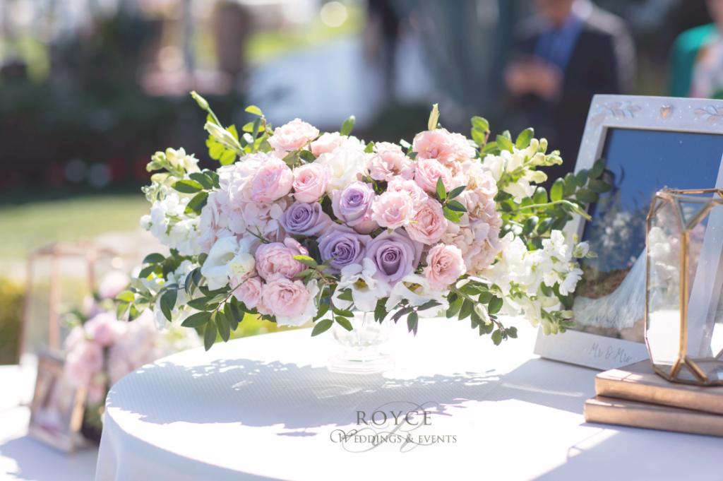 Lavender wedding flowers and wedding centerpieces created by OC wedding planner. http://RoyceWeddings.com Call: 626-560-2537